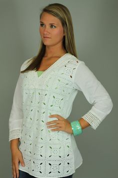 Get an expensive look without the expensive price tag! This top has DETAIL!!! We all agreed that this tunic has a beachy feel to it. From the embroidery, to the small dot detailing around the neckline and wrists, this top is beautiful! The deep v-neckline makes it easy pair your favorite necklace with it! Jeans or white pants with a pair of gold espadri...
