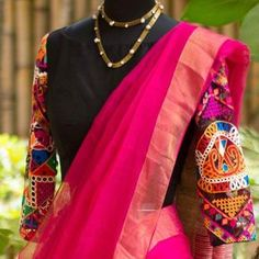 Here is a complete guide on how to wear plain sarees with kutch work blouses! These blouse designs are cool and comfortable to flaunt any day. Saree Blouse Models, Black Saree Blouse, New Saree Blouse Designs, Saree Blouse Patterns, Choli Designs, Kutch Work Saree, Kutch Work Designs, Work Blouse, Indian Designer Wear