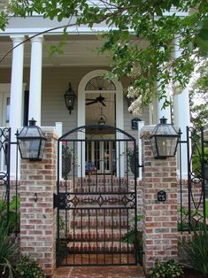 iron and brick fence entry traditional with front entrance outdoor ceiling Café Exterior, Painted Exterior Doors, Exterior Remodel, Colonial Exterior, Modern Exterior, Exterior Design, Front Gates, Entrance Gates, Entrance Design