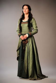 Labyrinth (2012 mini-series). It looks like the outer dress is slit up to her hip - it doesn't look bunched. That's hella OOP, but the rest of the outfit looks good.