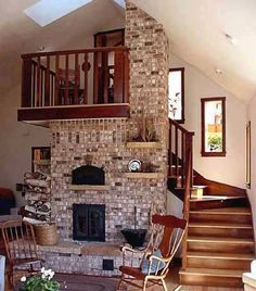 beautiful wooden stairs wrapped around stone hearth