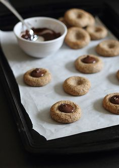 Almond chocolate thumbprint cookies... fill with chia jam of any sort, or chocolate almond butter (Jason's is my favorite!), and these are KETO!!!