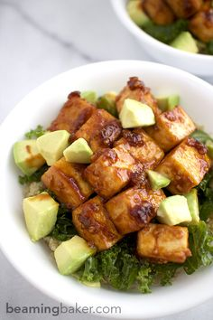 Tangy, sweet and smoky BBQ Tofu Bowls: big, juicy bites of tofu mouthwateringly glazed in barbecue sauce served with kale, quinoa and avocado.