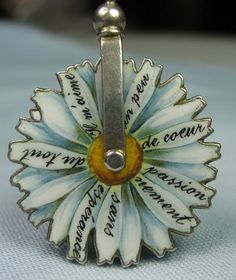 French enamel daisy lovers' spinning wheel .(love me love me not...).