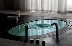 Google Image Result for http://www.strictlyitalian.com/wp-content/uploads/2009/10/sorgente-bathtub-lenci-design.jpg