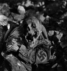 The remains of a Nazi official lie in the rubble after the Allied Bombing of Dresden. February 1945. Image by Germanpress photographer and photojournalist Richard Peter.