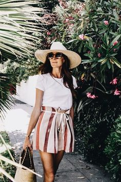 Striped skirt with white tee and cute hat.
