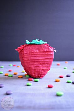 Craft these adorable mini strawberry pinatas to give away as a party favor at your next summer soiree! These are a fun kids craft too!