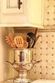 Use an old or inherited silver ice bucket for your wooden spoons or utensils, instant glam in the kitchen!  By Savy Souther Style.