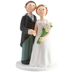 Figura para la tarta de boda que parece de azúcar. La novia lleva un vistoso ramo de largos tallos verdes