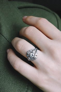 Stunning hand made vintage Art Deco engagement ring with delicate airy open filigree set with old European cut diamonds in platinum.