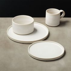 On sale. Shop Ecru Natural Dinnerware. Modern-shaped stoneware served warm in creamy, tonal ivory. Glazing process creates a light border ring around the pieces while organic rims keep things neatly inside.