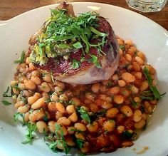Braised goat leg served with navy beans, bacon and mint at M. Wells Dinette, Long Island City. (Photo by: The Food Doc)