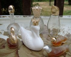 Collection of 7 lidded Avon perfume bottles1960's by ClassicCrow, $23.00
