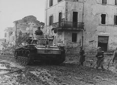 German soldiers advancing with a Panzer III, Italy, 1944.