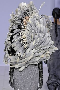 Swirling cloud of feathers // Peachoo + Krejberg  if i saw this walking down the street I would shot it...? by the by what bird lost his skin?