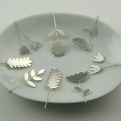 Nice, simple floral silhouettes from silver:  KristinaLici Jewellery