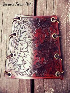 Custom Hand Carved and Tooled Leather Archery Arm Guard for Bow Hunting with Oak Leaves and Acorns. Hey, I found this really awesome Etsy listing at https://www.etsy.com/listing/198625574/hand-crafted-leather-archery-bow-hunting