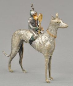 Lot # : 1825 - MONKEY JOCKEY ON DOG DRESDEN ORNAMENT