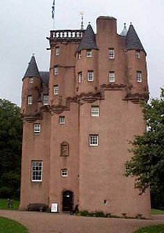 Craigievar is hidden in the wooded hills of Aberdeenshire. Looking as though it's come straight from a fairytale, this stylish 17th-century tower house is a fine example of the Scots baronial style of architecture. Seven storeys high, its sheer walls are topped by a riot of turrets, towers, crow-stepped gables and conical roofs which give it its distinctive character.