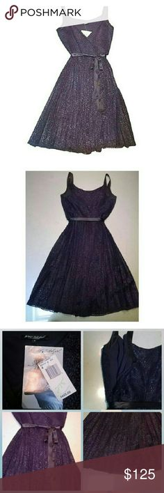 BETSEY JOHNSON Black Lace Tie Dress NWT $450 Betsey Johnson party dress. Black lace. Fully lined. Low V bodice. Tie bow around waste. Side zipper enclosure. A line. Would look perfect with pumps and a clutch for a night out. Love Betsey! Betsey Johnson Dresses Midi