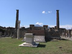 Temple of Apollo in Pompeii. Notice the altar, which, as always, is located before the temple steps. Also notic the white column on the left, which supports a sundial.