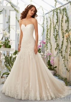Romantic and Ethereal, this Morilee by Madeline Gardner Fit and Flare Wedding Dress would look perfect at a Vineyard or Winery Wedding. A Sweetheart Neckline covered in Alencon Lace and Scalloped Edging. Style 5402.