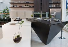 Spectacular..kitchen covered in Bianco Zeus and Tao from Silestone