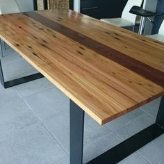Recycled bridge timbers.  Blackbutt and spotted gum on flat steel hoop legs. 2000 x 1000 x 740