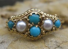 Victorian Turquoise & Pearl set in 14kt gold with twisted metal work and gold balls.