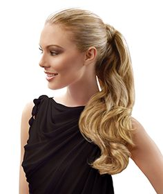 """Available colors       Any woman can now have a long, full, beautiful ponytail in an instant with the Long Wave Pony by Hairdo. Formerly the 23"""" Wrap Around Pony, this clever pony attaches easily and is made with Tru2Life® heat-styleable fiber, which means it can be curled or straightened with a curling iron or flat iron."""