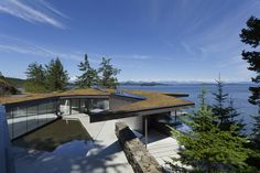 1 luxury green roofed island home large boulder Amazing Cliff House with Living Roof, Glass Floor and Courtyard Pool