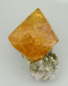 Sheelite with Muscovite from China by Fabre Minerals. via mineralia