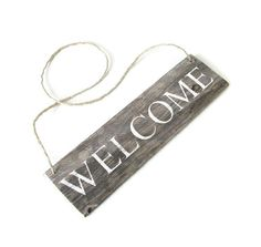 Welcome sign made from reclaimed fence wood. Comes ready to hang on twine. Measures 12in x 3 1/4in. Since each sign is handmade from