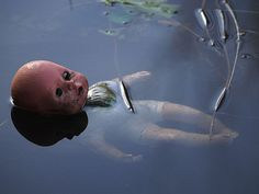 There is something creepy about abandoned dolls, but this one looks serene floating in the water...