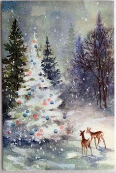 Deer looking at decorated tree