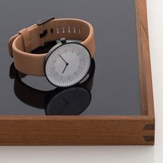 A textured black stainless-steel case mimics the appearance of cast iron, and is contrasted with a vegetable-tanned leather strap from Tärnsjö Garveri in Sweden.