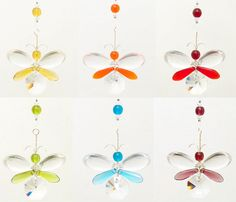 This sweet butterfly / fairy suncatcher / car charm has been hand crafted from Swarovski crystal & glass beads. It comes in a range of colours,