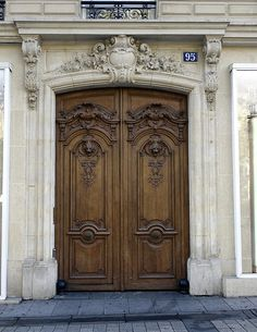 An Ornate Door On The Champs Elysees In Paris France
