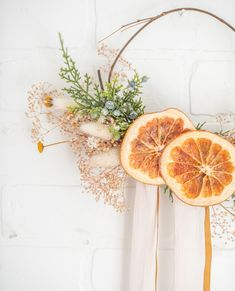 Create your own stunning fall grapevine wreath with a few simple florals. Start with a bare grapevine wreath, and choose some delicate florals like preserved gypsophilia, a faux berry pick, and some preserved oranges. Shop DIY fall wreath supplies at Afloral.com.