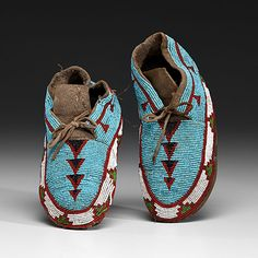 """Blackfoot Beaded Hide Moccasins, thread-sewn on thick hide; beaded using """"real"""" seed beads of light blue, rose, white, pea green, and faceted black, length 9.5 in. ca 1900"""