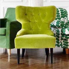 Apple green velvet chair.