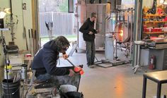 Artisans at work creating art glass in a corner of the large studio. Karg Art Glass, Kechi, Kansas. They welcome visitors, and we have stood around and watched them work. It's fascinating!