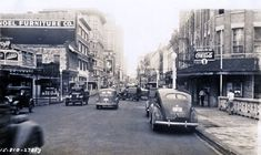 ca. 1940 - Commerce St. at Lasoya St./San Antonio River looking west