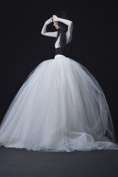 Longsleeve stretch illusion and satin faced organza ballgown with basque waist and dramatic tulle skirt