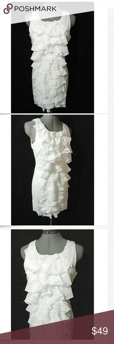 """Nwt MINUET Tuxedo Ruffle Tiered Dress M White chic Individual monitors may display slightly different colors or hues...  NEW WITH TAGS-  MINUET Chiffon Ruffle Dress  TAG SIZE: M or L BUST: M-34"""" L-38"""" armpit to armpit laid flat (have some stretch) LENGTH: 33-34"""" from the top of the shoulder down  Gorgeous Tiered Chiffon ruffles Scoop neck Stretch fit body Sleeveless Knee length Pencil style White in color NEW NEW NEW Minuet Dresses Midi"""