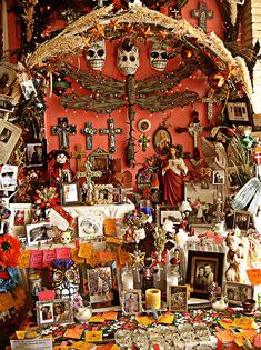 Dia de los Muertos with numerous crosses, skeletons and skulls, a dragonfly, and other icons.