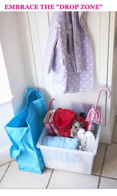 Drop zone! Use a storage box to throw stuff rather than the floor
