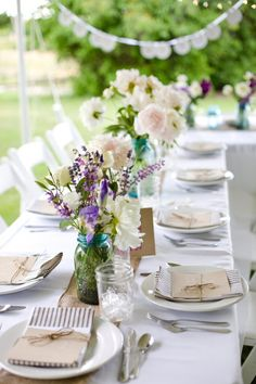 Floral arrangements are easy when put into Mason jars.  Loosely arranged with a coordinating ribbon - anyone can do them!