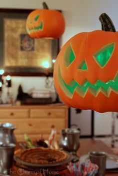 Put glowsticks inside your pumpkins!  These are hung with fishing wire but you could do it with real jack-o-lanterns, too.